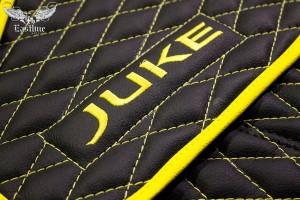 Черно-желтые ковры в салон Nissan Juke.