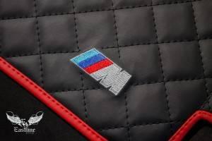 Комплект автомобильных ковриков из экокожи для BMW M5.