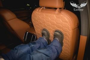 Porsche Cayenne изготовление защитной накидки на спинку сиденья от детских ног.