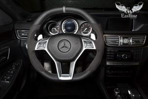Mercedes-Benz E63 AMG S-Modell комбинированная перетяжка руля в кожу и алькантару, аквапринт салонного пластика и изготовление бокса в багажник